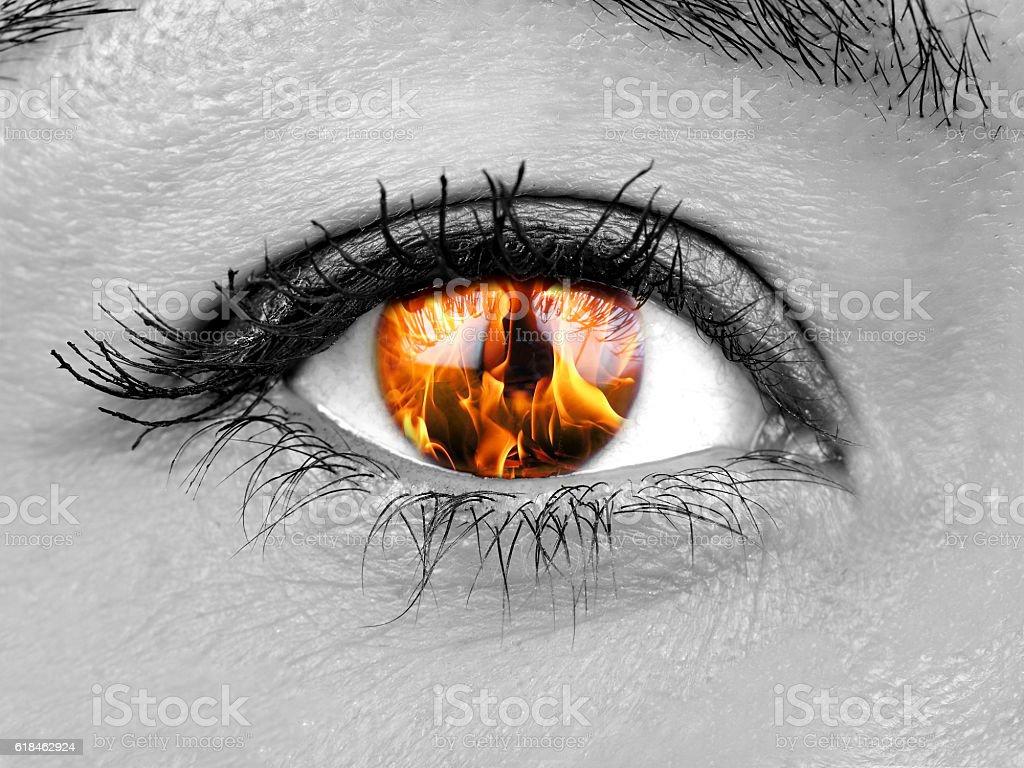 Closeup female eye iris burning stock photo