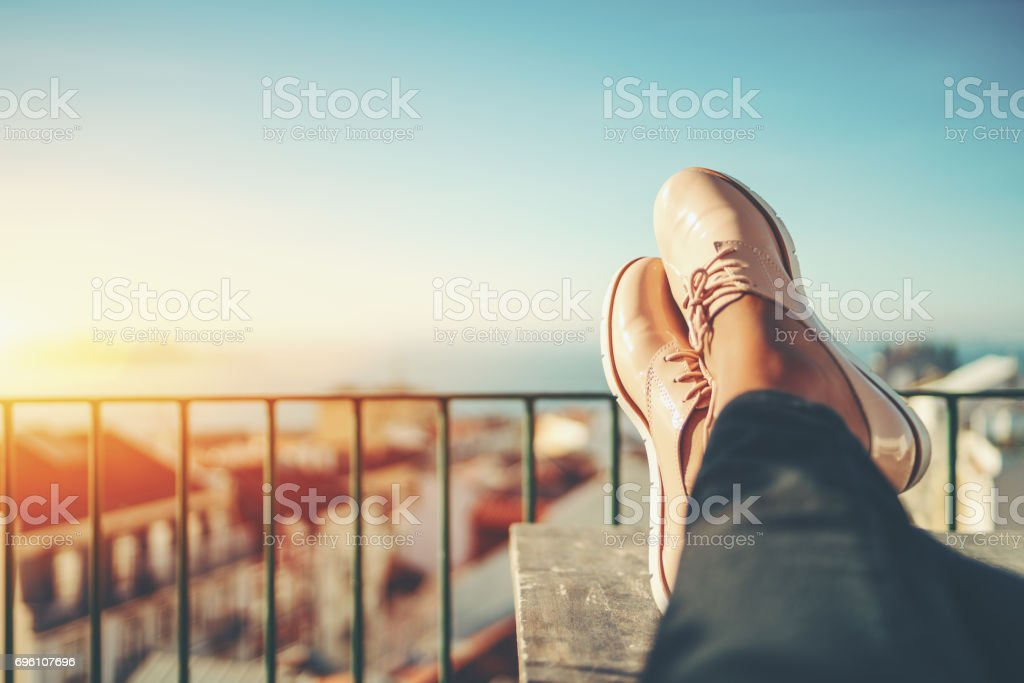 Close-up female feet resting on table stock photo