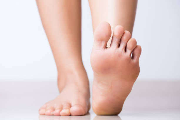 closeup female foot pain, healthcare concept. - podiatry stock pictures, royalty-free photos & images