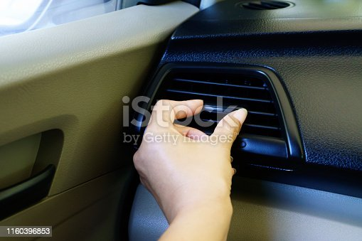 istock Closeup female hand adjusting air ventilation grille - Air conditioning 1160396853
