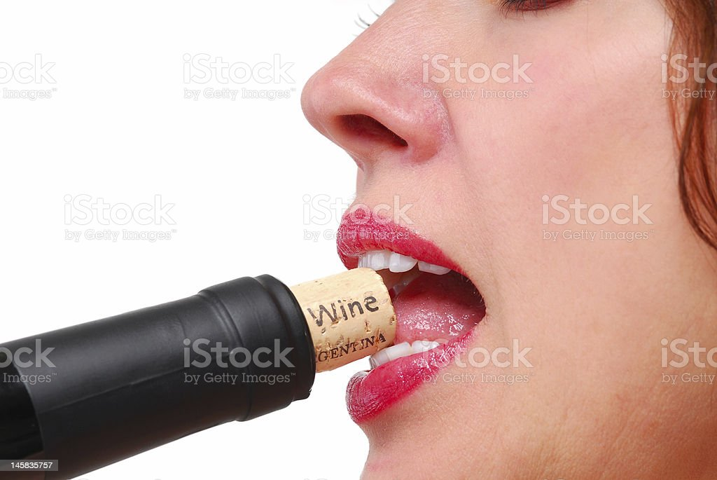 Close-up Female Lips with Red Lipstick and Wine Bottle Cork stock photo