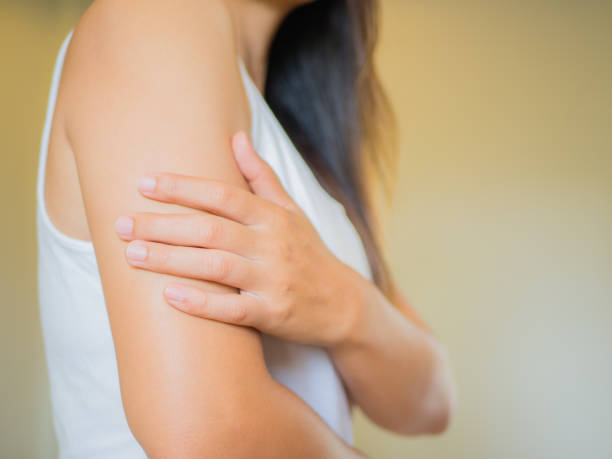 Closeup female's arm. Arm pain and injury. Health care and medical concept. stock photo