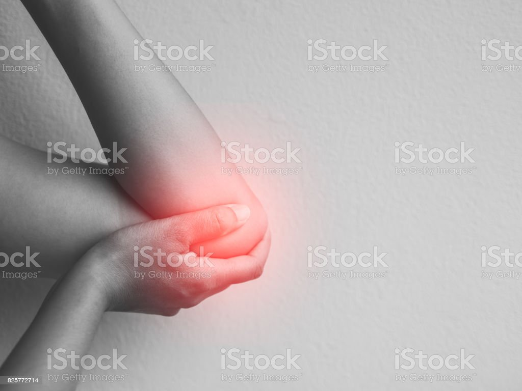 Closeup female's elbow. Arm pain and injury. Health care and medical concept. stock photo
