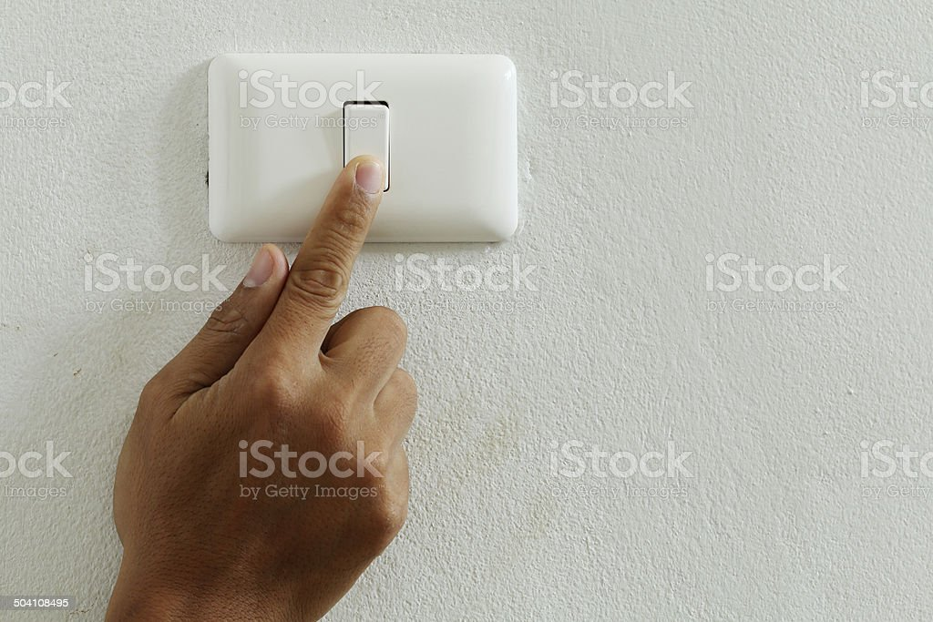 closeup finger press turn on/off electric-switch stock photo
