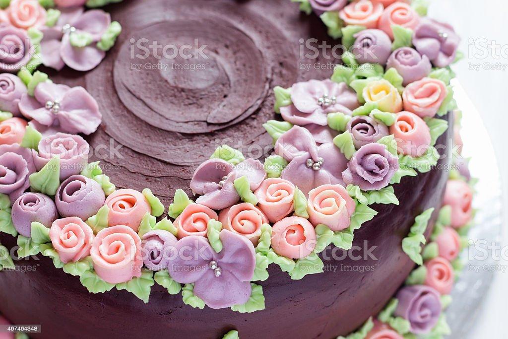Closeup floral decoration on chocolate cake stock photo