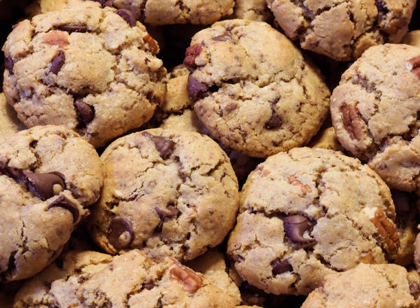 Closeup Focus Stacked Image of Homemade Chocolate Chip Cookies Closeup Focus Stacked Image of Homemade Chocolate Chip, Pecan and Oatmeal Cookies chocolate chip cookie stock pictures, royalty-free photos & images
