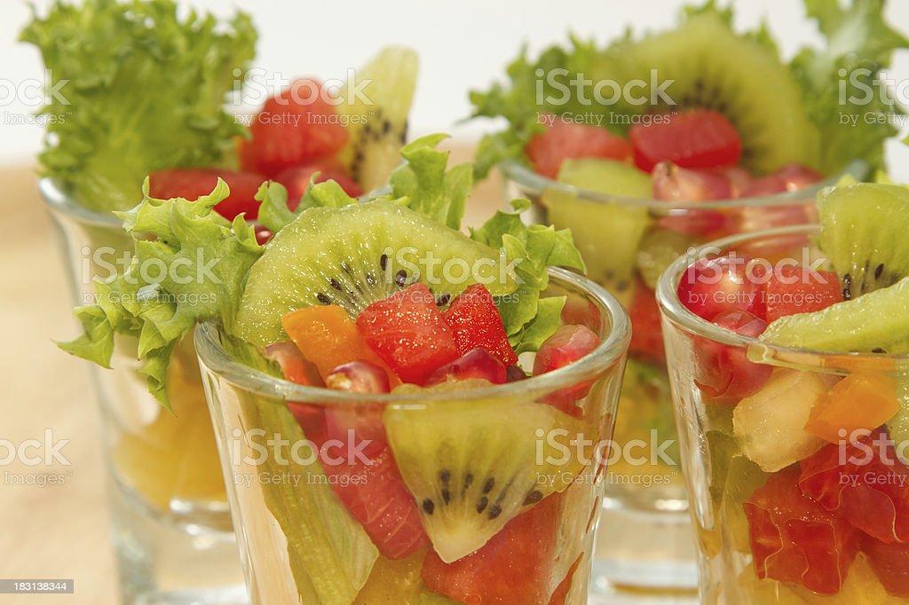 Closeup Fresh fruit salad in glasses royalty-free stock photo