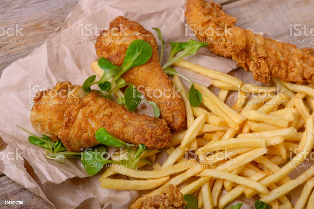 Closeup fried chicken meat and potato stock photo