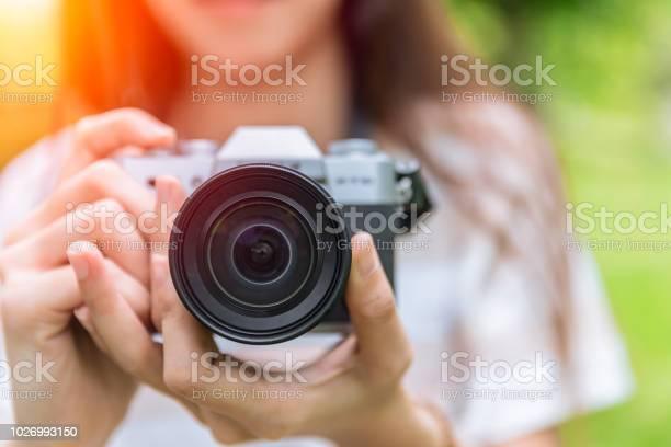 Closeup front lens of mirrorless camera in woman teen photographer picture id1026993150?b=1&k=6&m=1026993150&s=612x612&h=5n2egfsj3pre6v6rt kcfi50ku o5 r8kufvs50njh0=