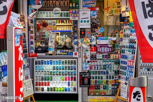 Osaka, Japan, January 16 2019 : Closeup front of small Japanese cigarette shop with fully and variety cigarette on shelves. Cold weather and work stress thus making Japanese people more in smoking.
