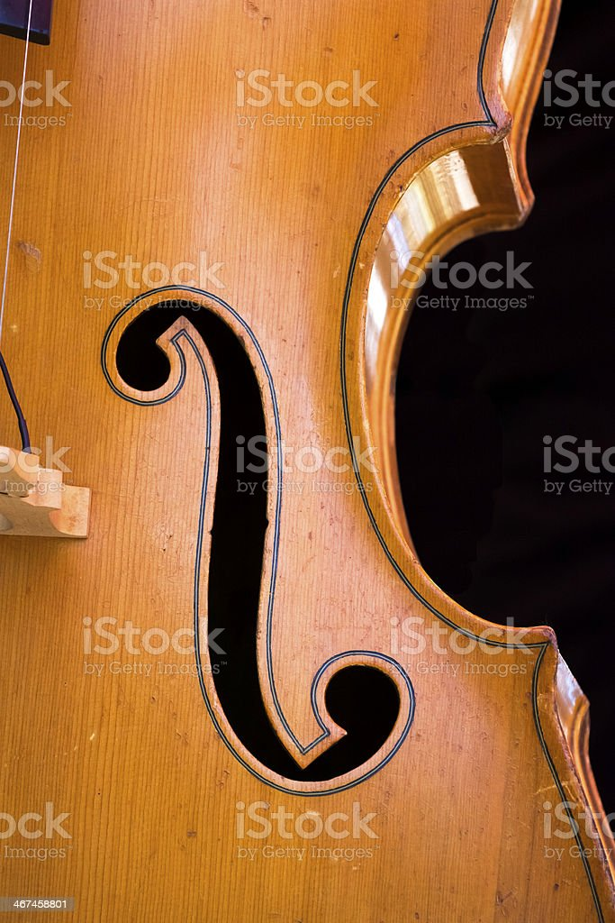 Closeup front view of contrabass against black background, copy space stock photo