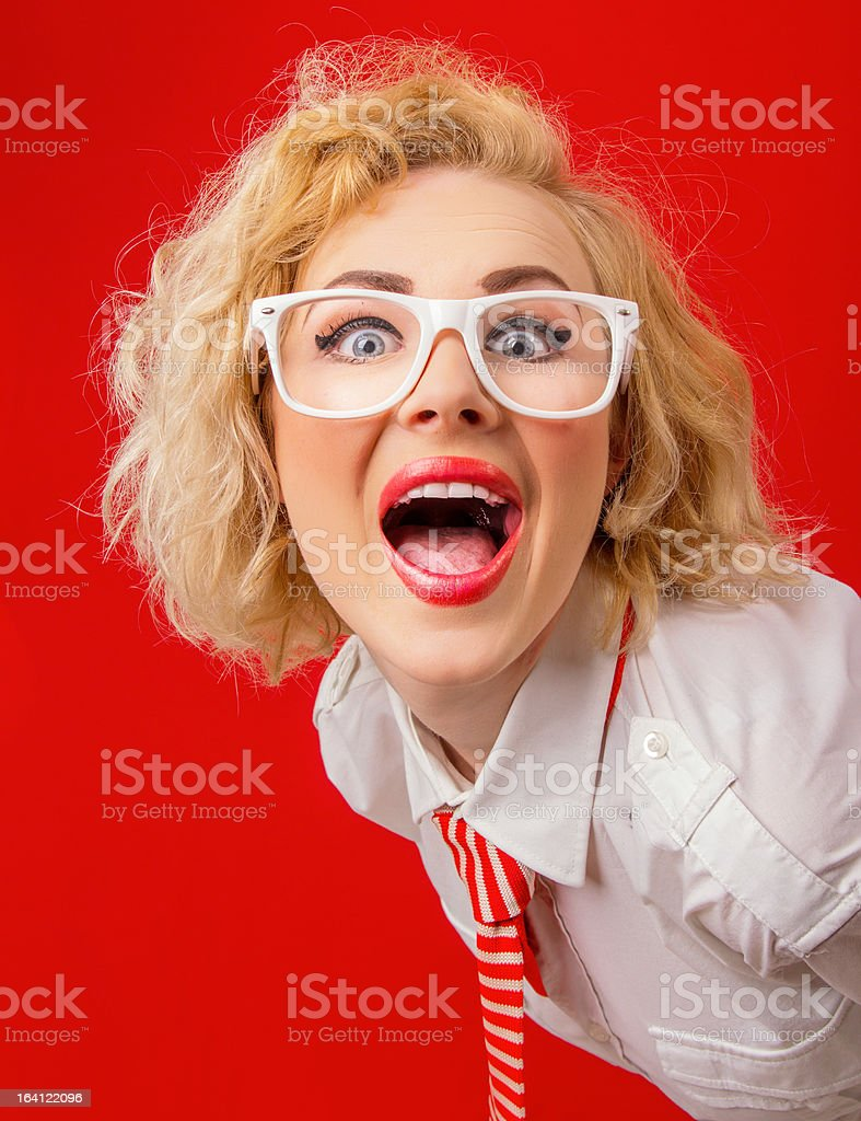 Close-up funny woman screaming, isolated on red background royalty-free stock photo