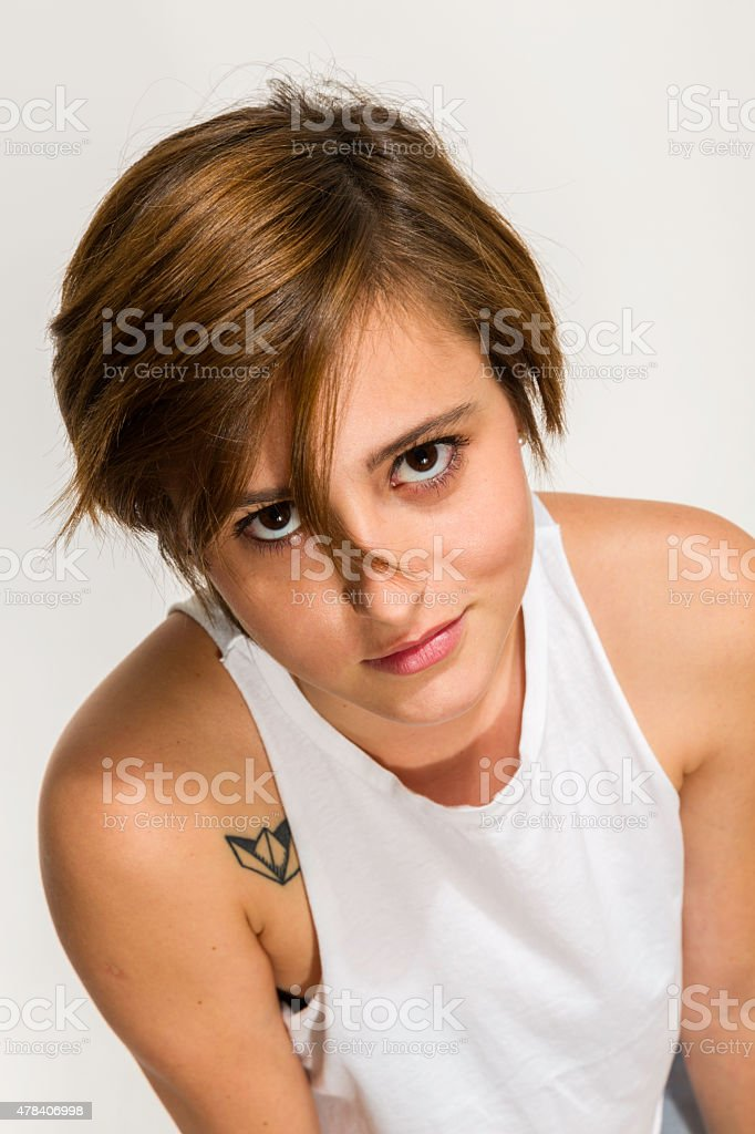 Close-up  gender fluidity young woman with attitude and short hair stock photo