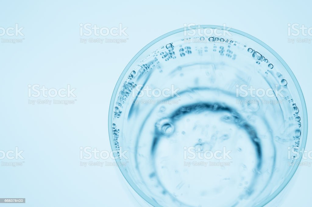 Closeup glass of mineral water with air bubbles of carbonic acid stock photo