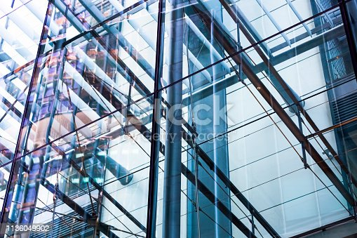 Closeup glass office building metal structure and reflection, background with copy space, full frame horizontal composition