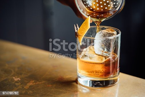 istock Closeup Glass with Alcohol in Cocktail Bar 974765782