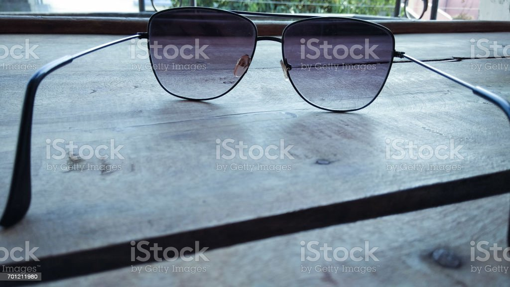 closeup goggles background and fashion sunglasses on , wooden table stock photo