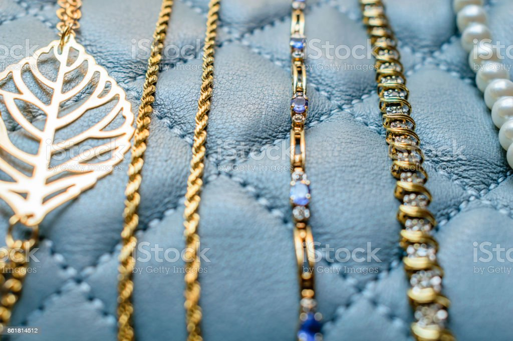 Closeup Gold, Gem, and Pearl Bracelets stock photo