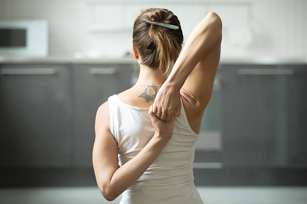 closeup gomukasana pose - gymnastik tattoo stock-fotos und bilder