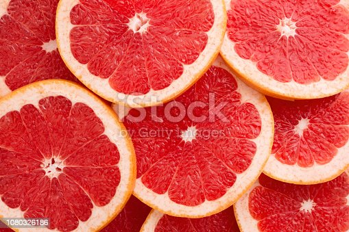 istock Close-up Grapefruit slices abstract background in Living Coral color. 1080326186