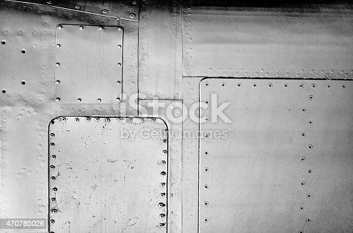 istock Close-up gray painted aluminum aircraft sheet metal background texture 470785026
