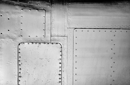 Close-up gray painted aluminum aircraft sheet metal background texture