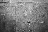 Close-up gray painted perts old submarine metal panel background texture, rivets, dots, line