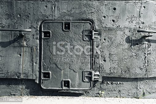 Close-up gray parts old submarine, sheets metal, closed door, background texture