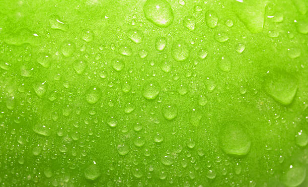 Close-up green apple with waterdrops stock photo