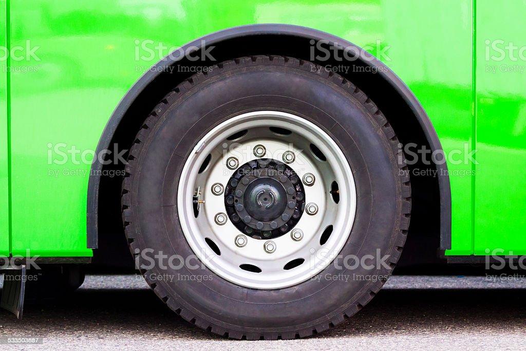 Closeup green bus wheel, full frame horizontal composition stock photo