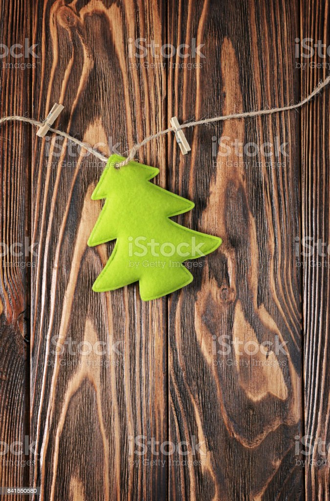 Close-up green felt toy Christmas tree stock photo