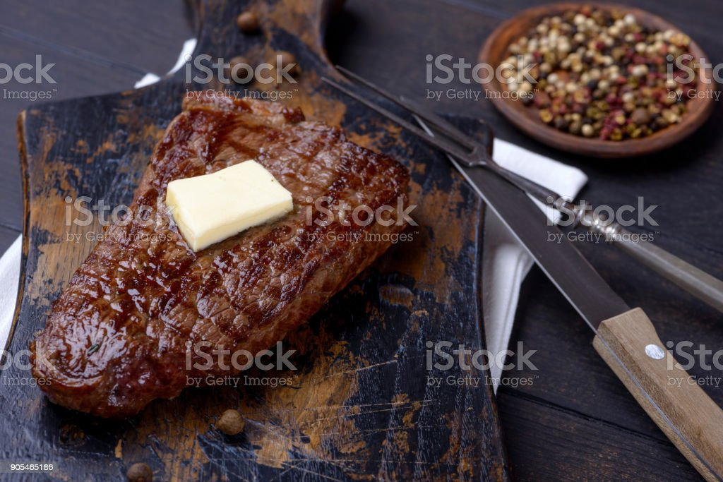 Closeup grilled beef steak and butter stock photo