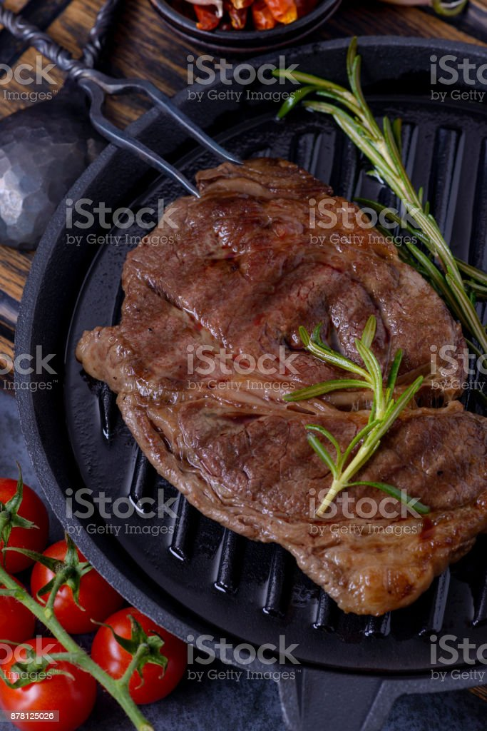 Closeup grilled beef steak with rosemary stock photo