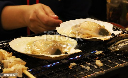 Close-up grilled crab and clams on the grill in a restaurant in Japan.