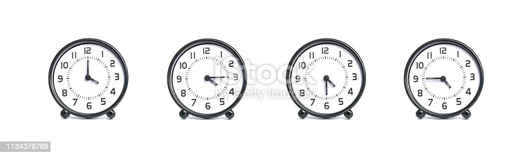 Closeup group of alarm clock for decoration show the time in 4 , 4:15 , 4:30 , 4:45 p.m. isolated on white background