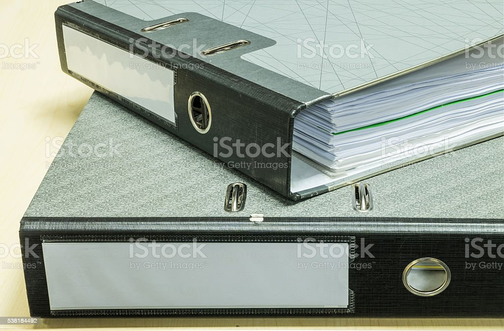 Closeup group of document file on wood desk background stock photo
