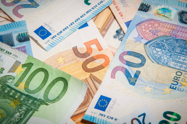 close-up group of euro money banknote: 20 euro 50 euro 100 euro banknote: 20 euro 50 euro 100 euro thrown on the ground euro symbol stock pictures, royalty-free photos & images