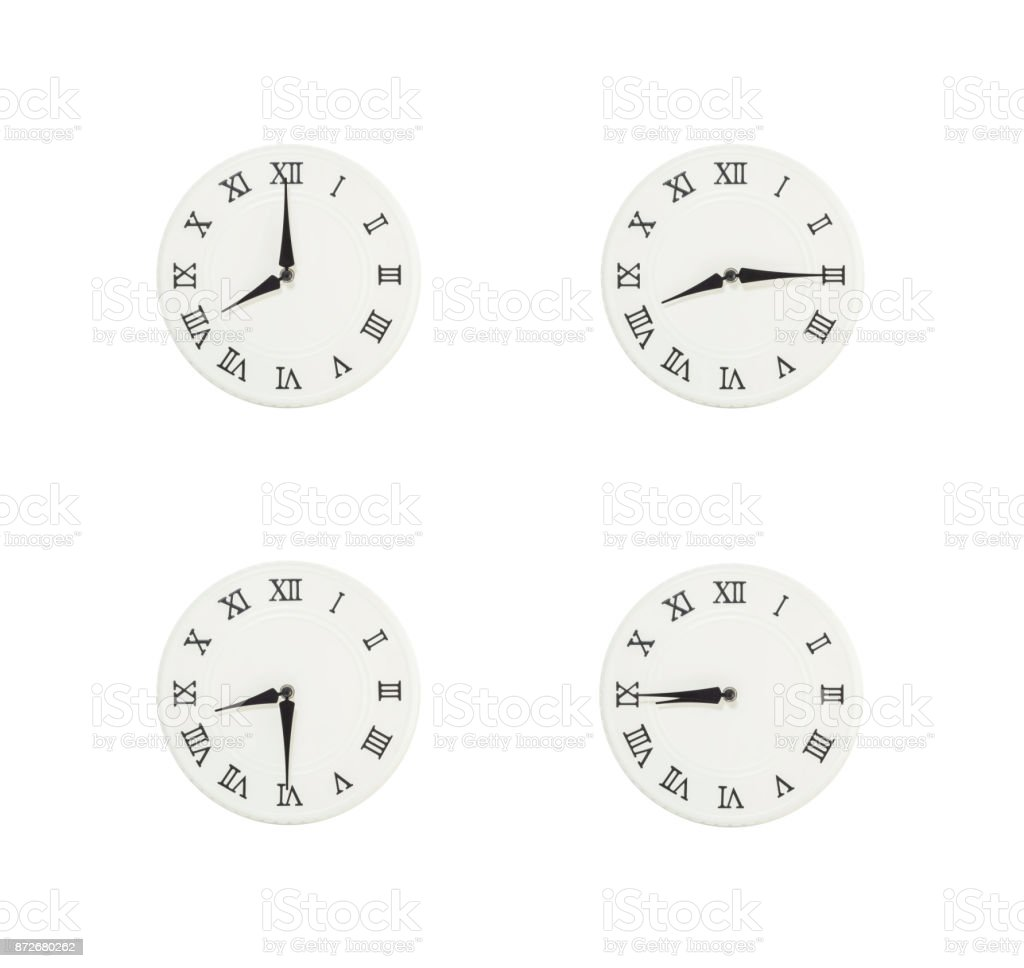 Closeup group of white clock with shadow for decorate show the time in 8 , 8:15 , 8:30 , 8:45 a.m. isolated on white background , beautiful 4 wall clock picture in different time stock photo