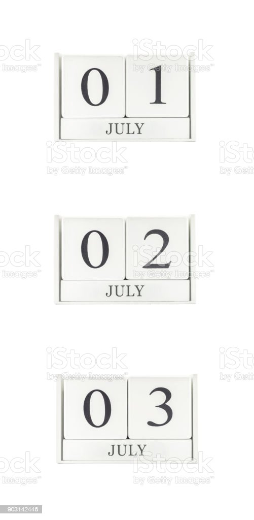 Closeup group of white wooden calendar with black 1 july , 2 july , 3 july word , three date calendar isolated on white background stock photo