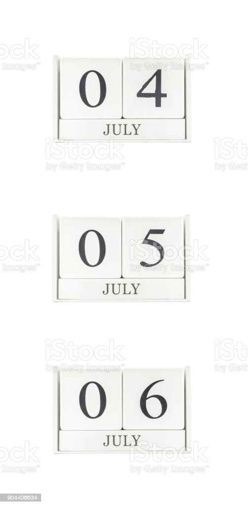 Closeup group of white wooden calendar with black 4 july , 5 july , 6 july word , three date calendar isolated on white background stock photo