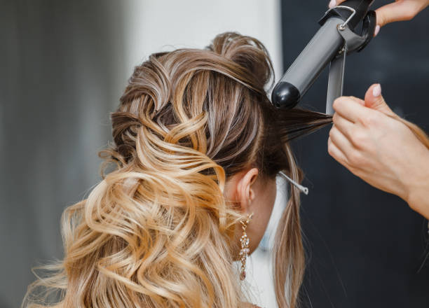 Closeup hairdresser coiffeur makes hairstyle. Closeup hairdresser coiffeur makes hairstyle. saloon stock pictures, royalty-free photos & images