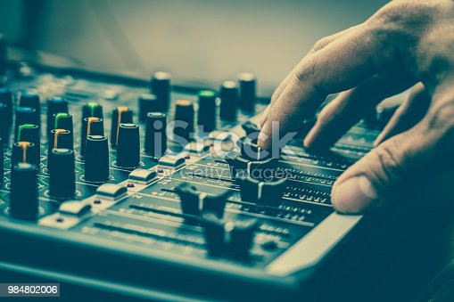 istock Closeup hand adjust the audio mixer, music equipment concept 984802006