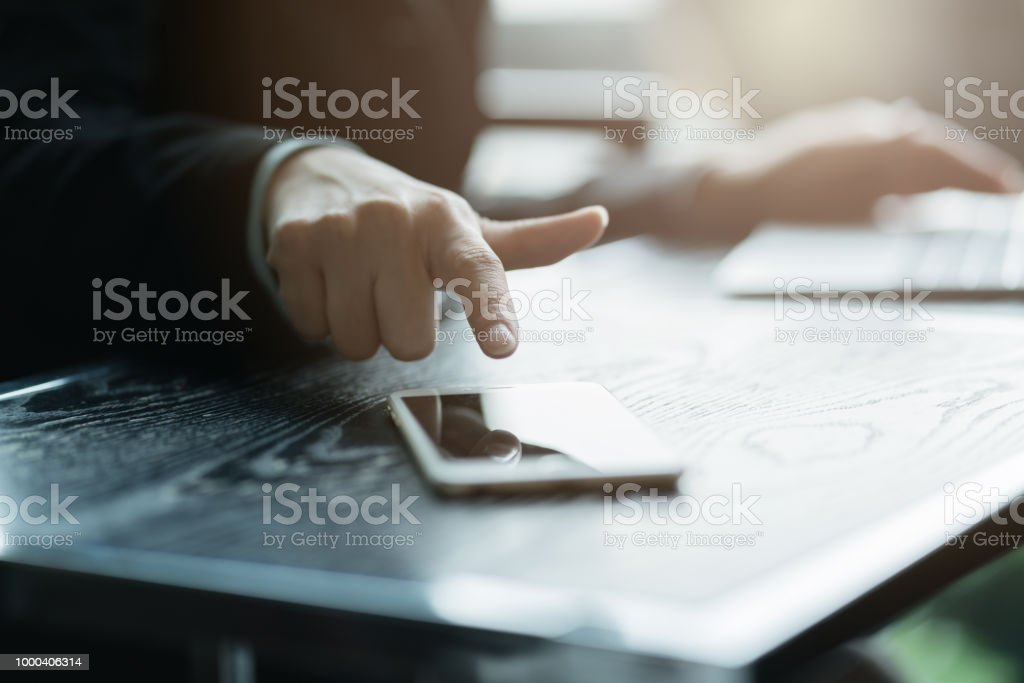 closeup hand finger point to mobile smartphone business ideas concept