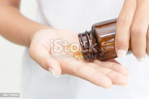 istock closeup hand holding fish oil vitamin for healthy 494128844