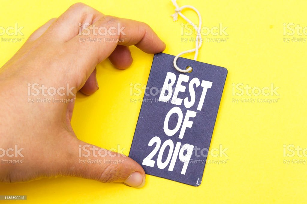 closeup hand holding tag with best of 2019 stock photo