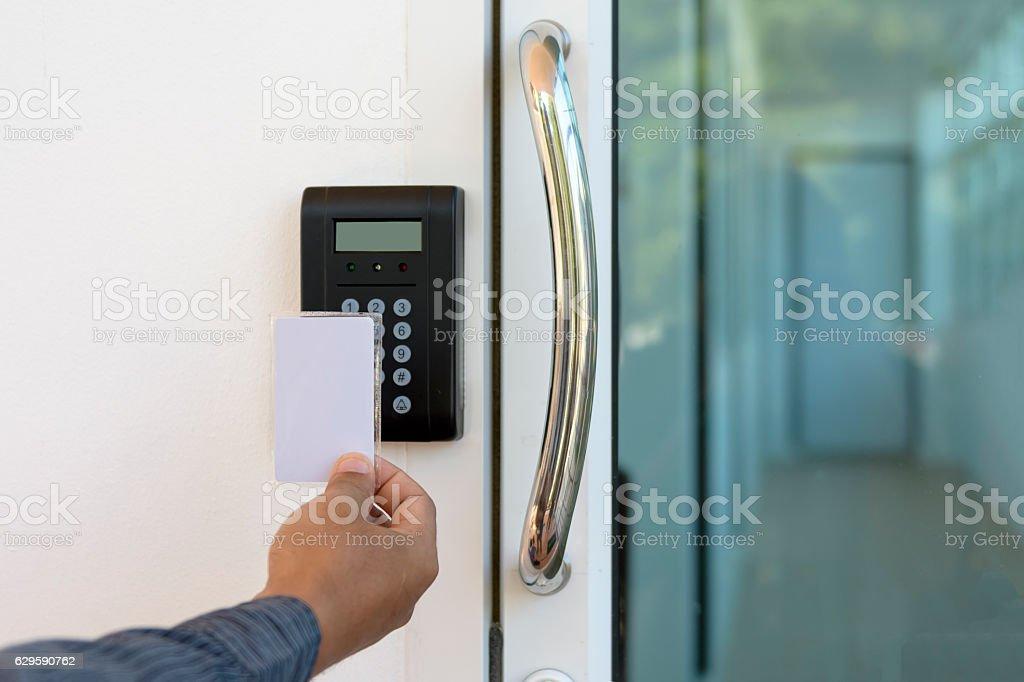Close-up hand inserting keycard to lock and unlock door stock photo
