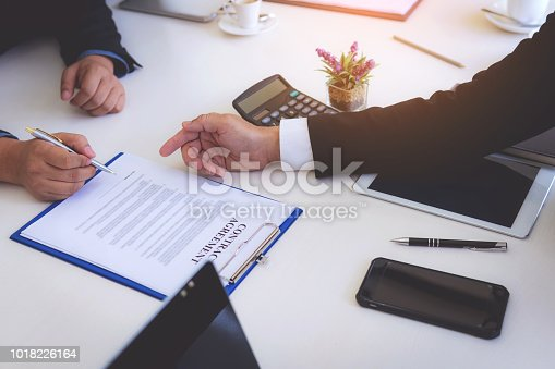 1008974324 istock photo closeup hand of business man signing contract document 1018226164
