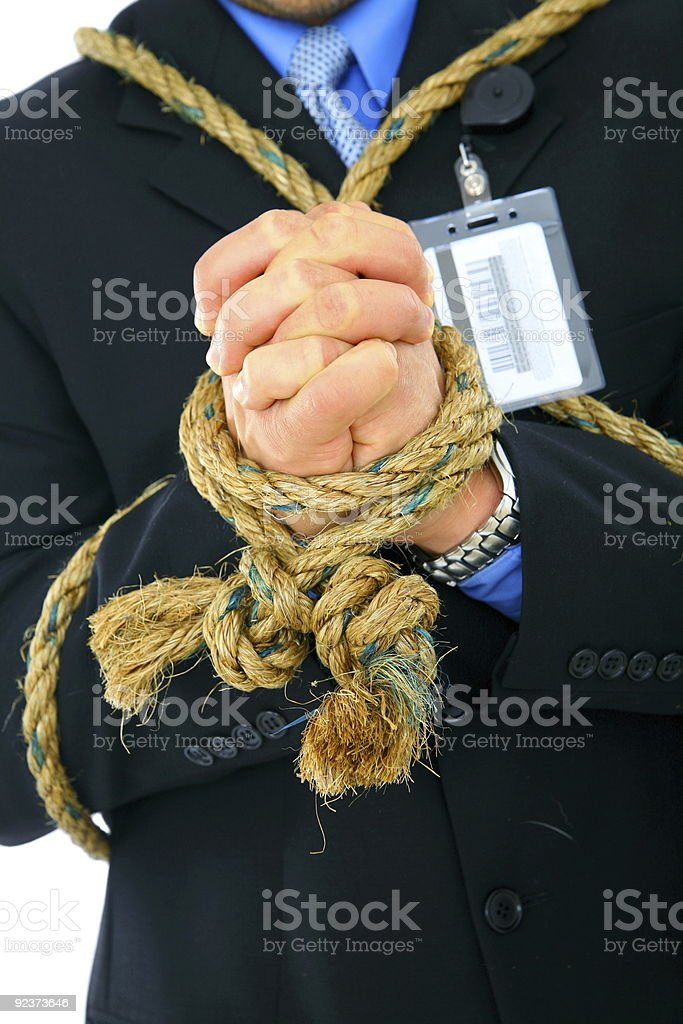 Closeup Hand Of Businessman Tied With Rope royalty-free stock photo