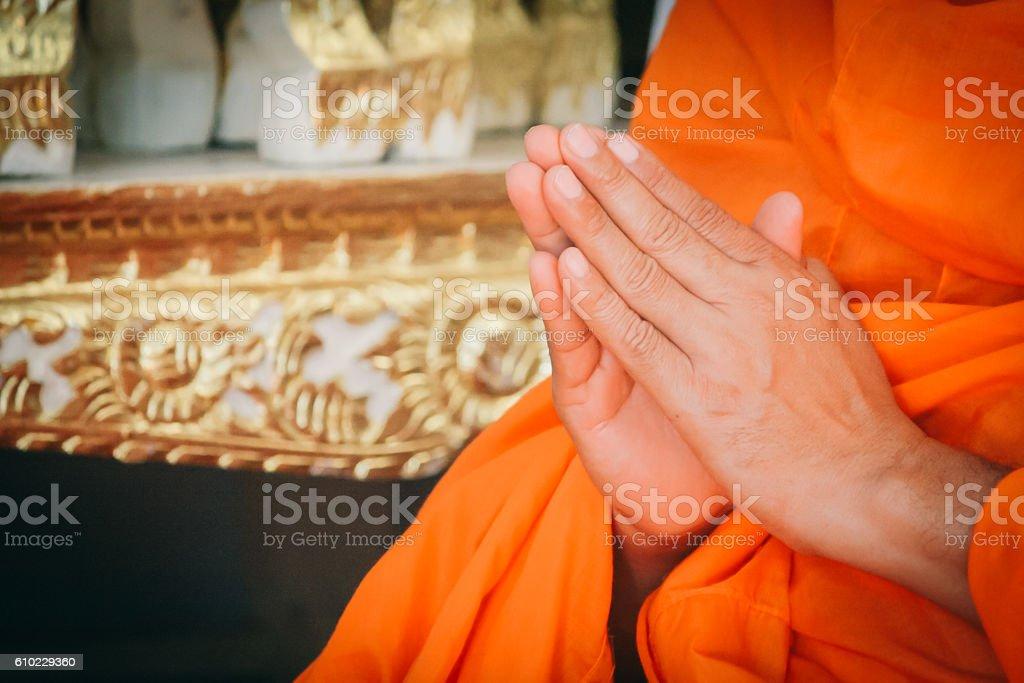 Closeup Hand Pray of Thai Monk. stock photo