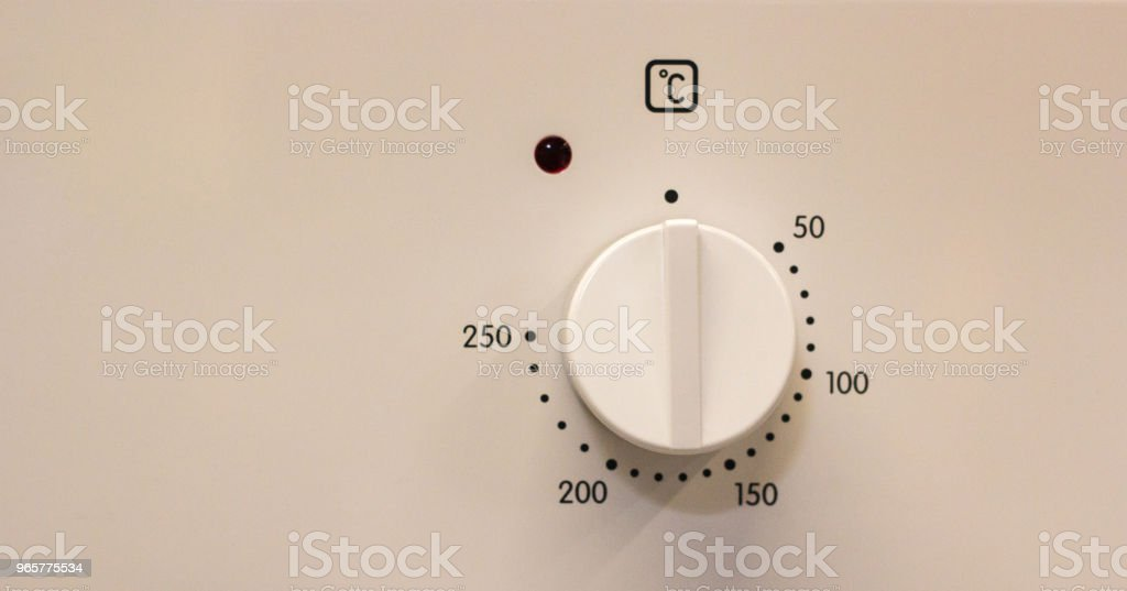 Close-up hand setting cooking mode or temperature on oven - Royalty-free Appliance Stock Photo